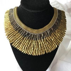 New. Gold iconic Pegasus Statement Necklace
